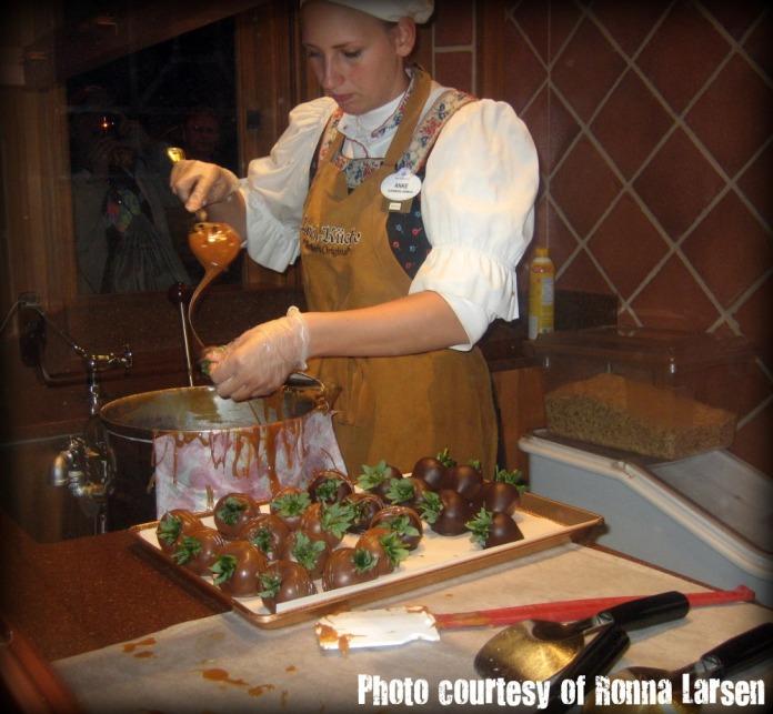 Making caramel strawberries.