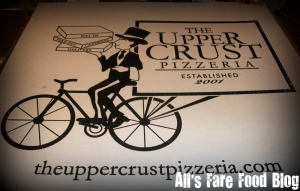 Upper Crust pizza box.