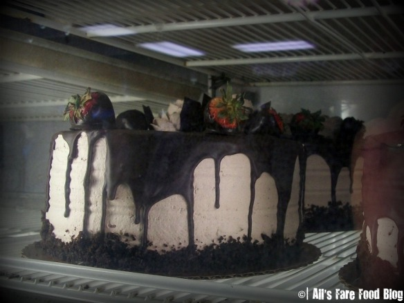 Chocolate cake in a display fridge at Mike's Pastries
