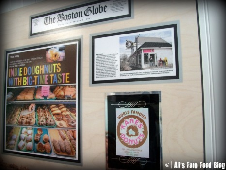 Newspaper clippings at Kane's Donuts