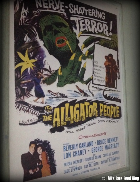 Movie posters lining the walls of Sci-Fi Dine-In Theater