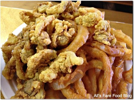 Fried clam platter with onion rings and fries at Woodman's of Essex